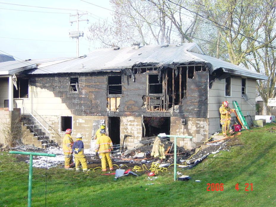 Daytime Photo of a house fire
