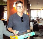 Josh Hartnett signing a mattel board game for the aucton