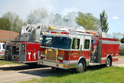 Eng 3 and Tower 1 at a house fire on Tracy Rd