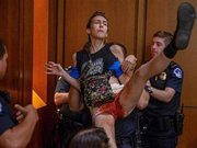 Insanity:  Gender fluid man being removed from Kavanaugh hearing