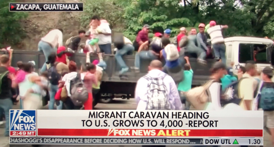 Notice Anything About The White Truck Helping the Caravan Of Illegals Try and make Their Way to the U.S. Border