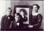 Eva (Norland) Wangen with picture of Louis Wangen along with sons (l-r) Efford and Edward Wangen