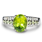 9x7MM Peridot And 1.00MM White Topaz Silver Ring