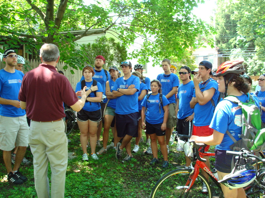 Ed Murphy talk to Bike and Build volunteers about housing development in Poughkeepsie
