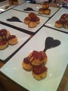 Caramel Profiteroles filled with Orange Zest Cream and served with Chocolate Orange Sauce