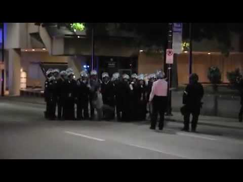 G20 Police State 25 - Police manhandle arrested student for group police photo op Unbelievable