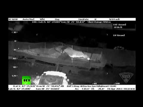 Helicopter video of Boston bombing suspect hiding in boat