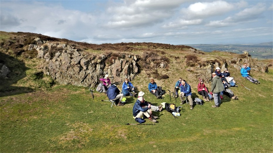 A breather on top of Caer Caradoc Hill, Shropshire, March 2019