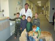 Dr. Flanigan, the boy and the dogs