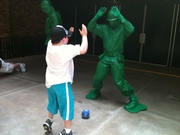 Billy doing his best jumping jacks with green army man at Hollywood Studios after Imaging DMD trip