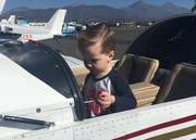 My great nephew with his hand on the throttle