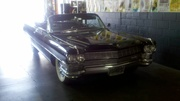 1964 Triple Black Caddy Emerging from Time Warp