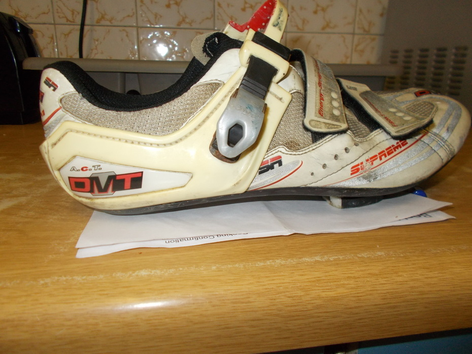 """""""DMT"""" brand cycling shoes."""
