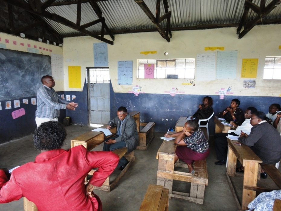 Mr. Muya, the headteacher, also leads a session.