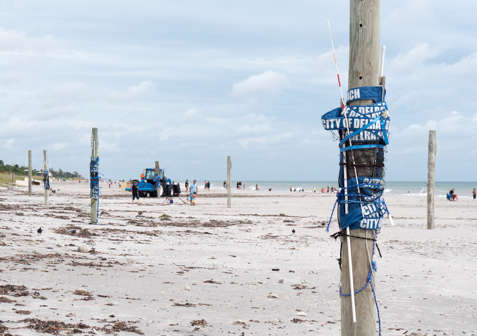 Cleaning up at the south end of of the municipal beach in Delray