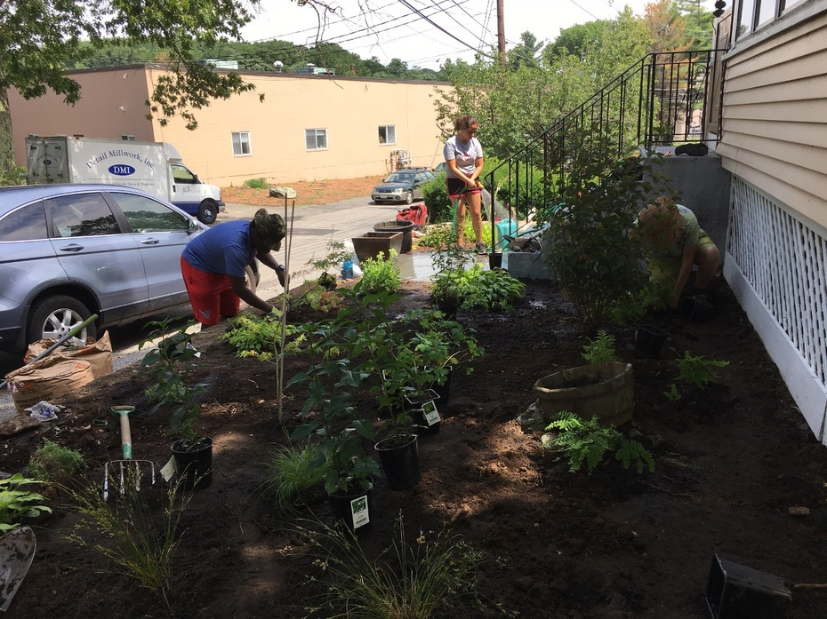 YEEP students maintaining a customer's front yard