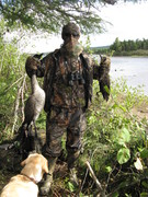 Jeff with a goose and black duck