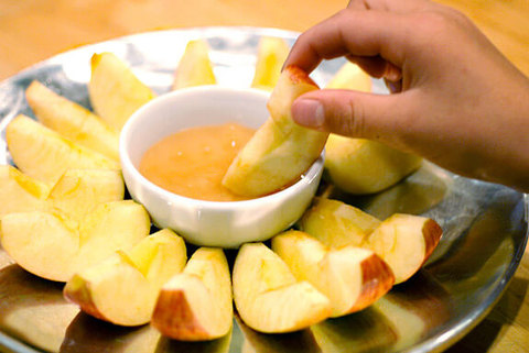 (dipping apple slices in honey)
