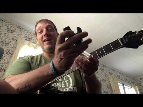 Ian C. Bouras trying a Holzer guitar, right out of the box