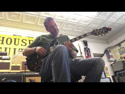 Ian C. Bouras performs at The House of Guitars