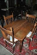 Antique Oak Table and 4 chairs with 5 additional Leaves Total Table length 7 inches