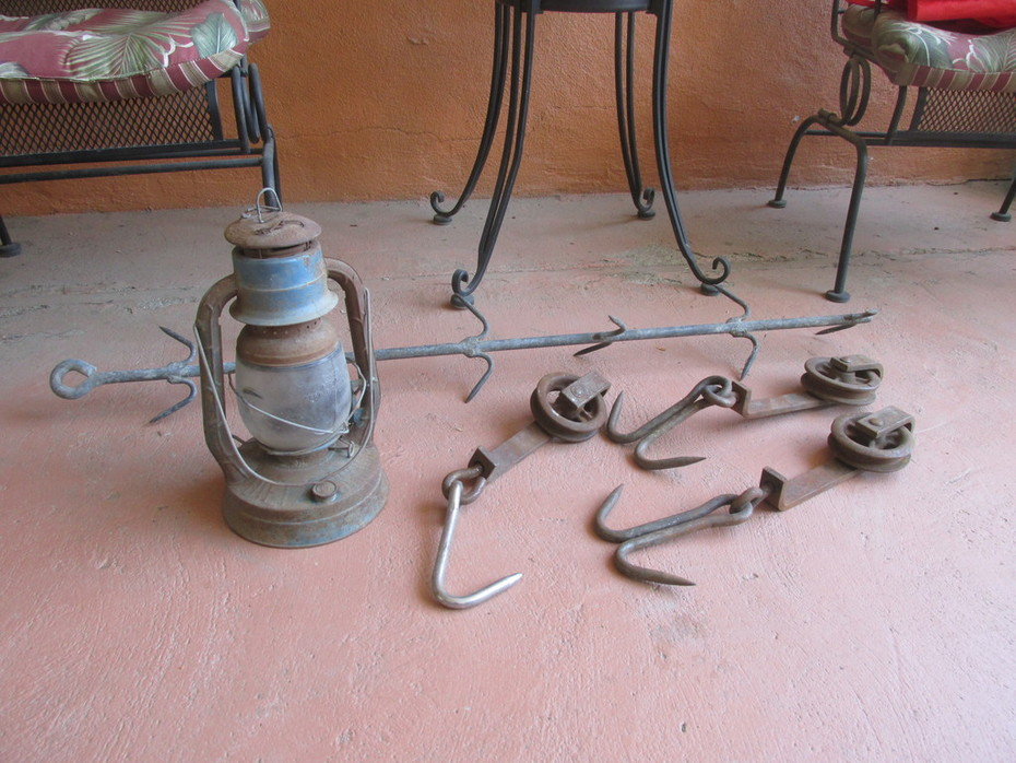 Meat hooks and an old Dietz lantern