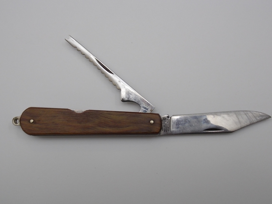 Geo. Schrade  Knife Co. Inc. Stainless Bpt. Conn. is Bridgeport, Ct. 1940-1956 4 and 7 eigths inches curley wood scales