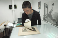 PhD student, Julien Faure-Conorton, shows the newly discovered Demachy print. Photo: Mark Green, NMeM