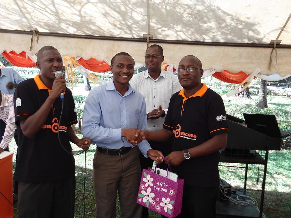 Male student winner of Open Access  gift hamper at Pwani University