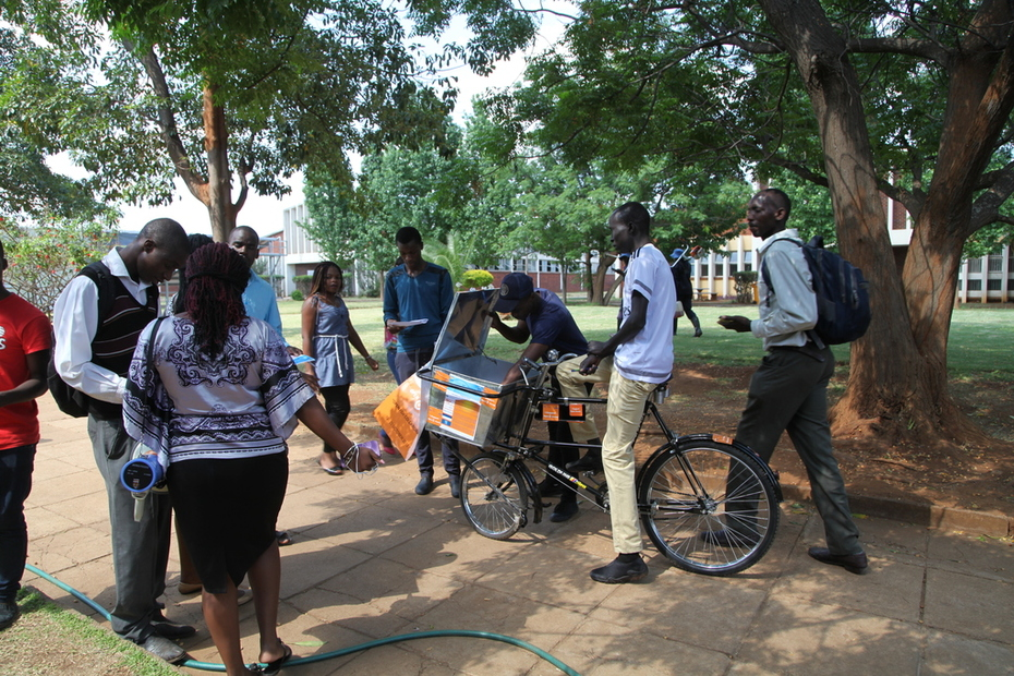 OA Bike Man with OA Student Leader attracting fellow students with Power Megaphone OA Mesages