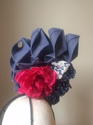 Rear view of navy origami style percher
