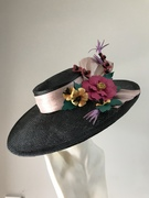 Custom black boater with leather flowers to match dress