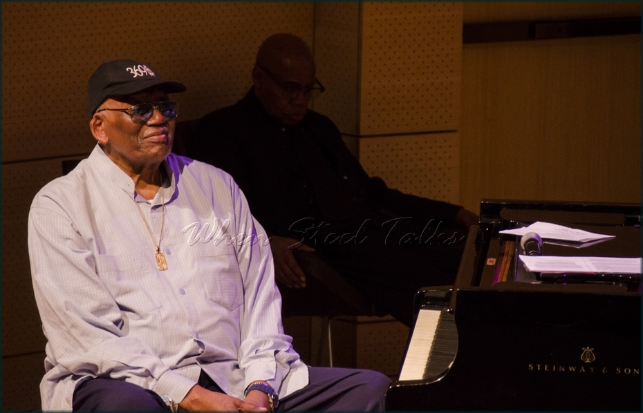 Randy Weston takes in Khuent Rose's demonstration of the double second steelpan at the symposium held in the Tishman Auditorium, New School, New York