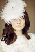 feather saucer hat