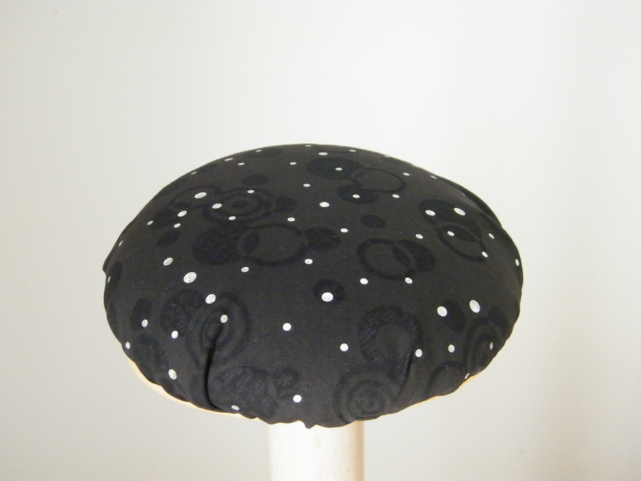 black and silver cocktail hat