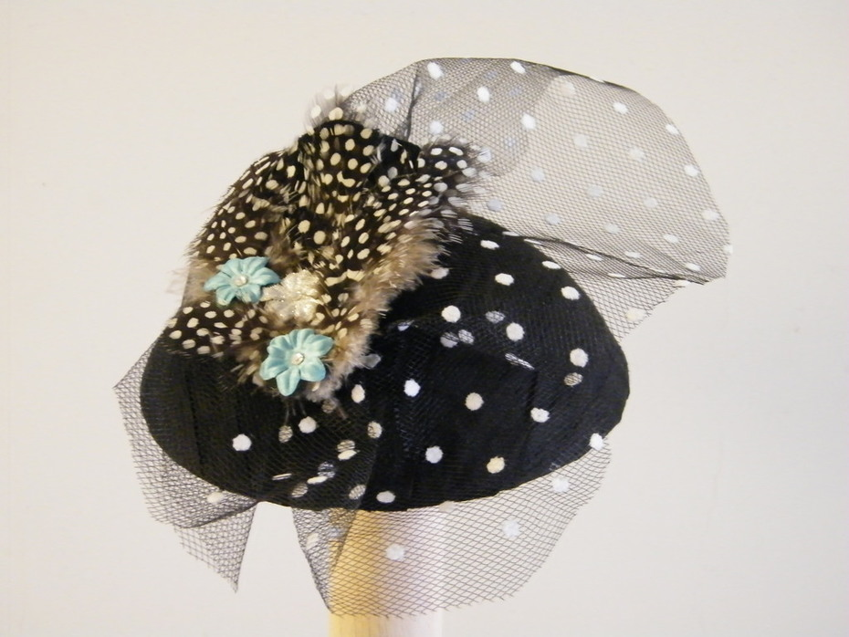 Silk cocktail hat with tulle, feathers and beads