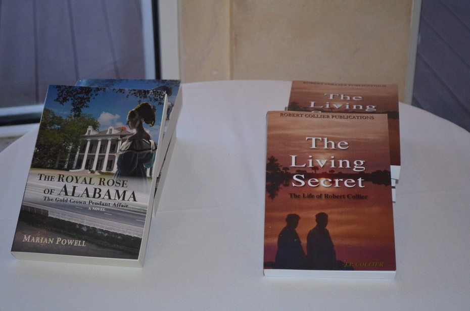 The Royal Rose of Alabama and The Living Secret, The Life of Robert Collier books on display