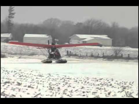 Quicksilver Ultralight Light Sport Airplane - Quicksilver Sprint II With Floats Landing on Snow - ht