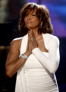 In this Nov. 22, 2009, file photo, singer Whitney Houston receives the International Artist Award onstage at the 37th Annual American Music Awards in Los Angeles. Houston, who reigned as pop music's queen until her majestic voice and regal image were ravaged by drug use, has died, Saturday, Feb. 11, 2012. She was 48. (AP Photo - Matt Sayles, File)