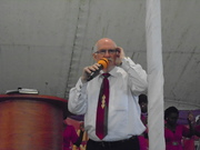 Preaching under the big tent for Dominion Church, Kampala, Uganda