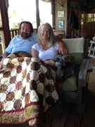My BFF Laurie sharing her quilt with her hubby and Ziggy