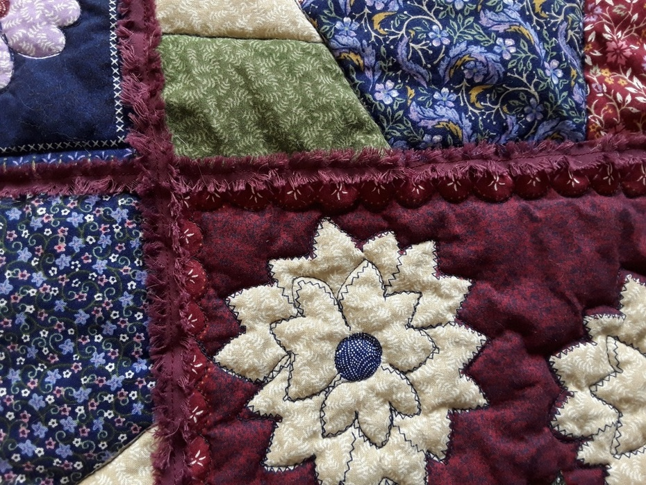 Chenille trimmed quilt.