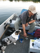My husband is determined to make Lulu become a fishing dog...