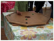 Kinda reminds me of Crokinole?