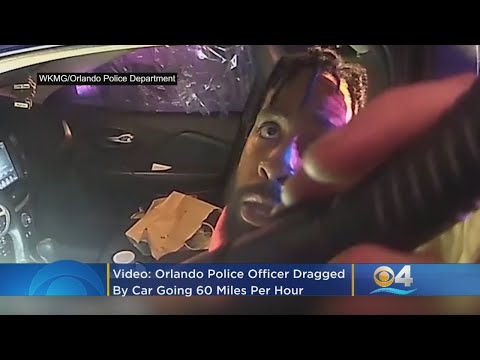 Orlando Police Office Dragged By Car Going 60 MPH While Hanging Out Window