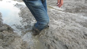 Rubber boots in soft deep mud