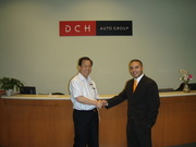Y.L. Man and Sean V. Bradley of Dealer Synergy at DCH Headquarters