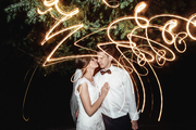 bride and groom with squiggly sparklers