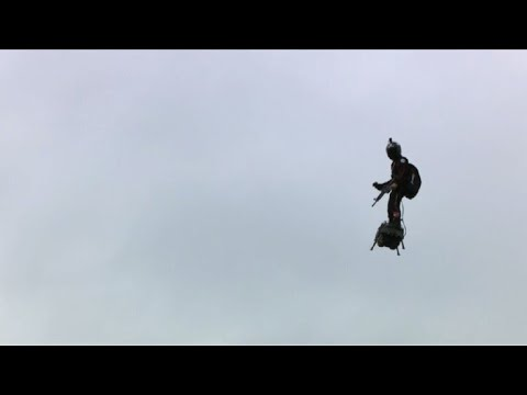 """A """"flying man"""" over the Champs-Elysees at Paris parade 
