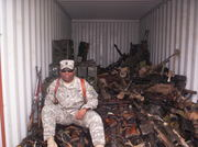 Spencer with confiscated insurgents weapons1